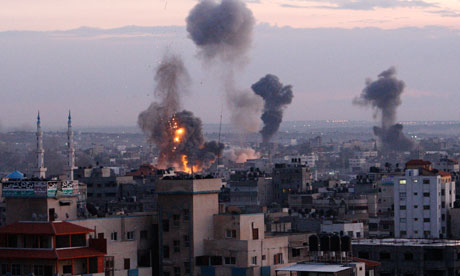 Smoke rises from buildings in Gaza City following Israeli airstrikes. Photograph: Adel Hana/AP